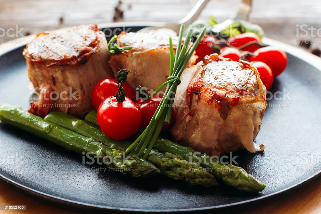 Meaty holiday dinner on a wooden table stock photo