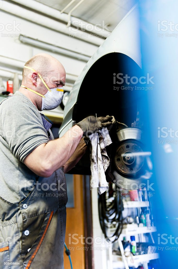 Mechanic Adjusting Brakes stock photo