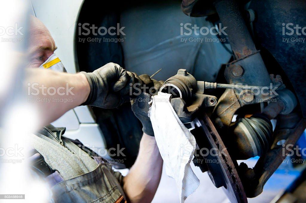 Mechanic Adjusting Brakes stock photo