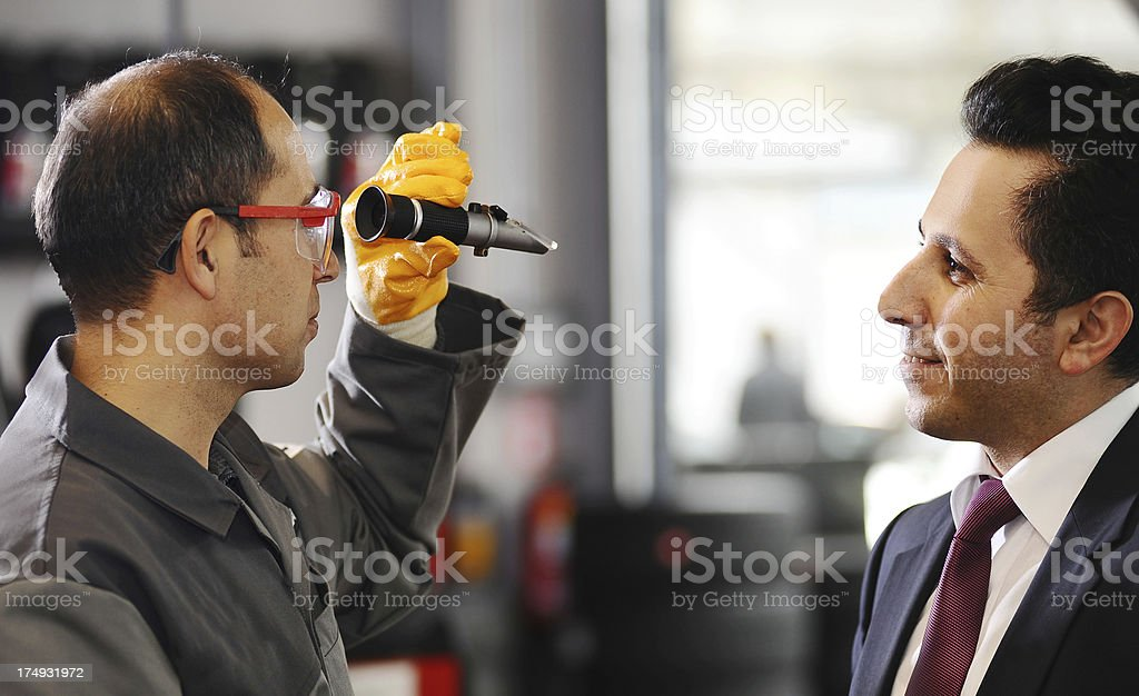 Mechanic and client royalty-free stock photo