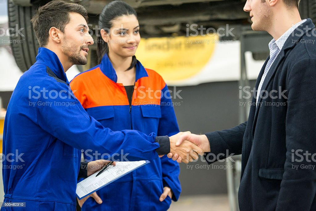 mechanic and customer stock photo