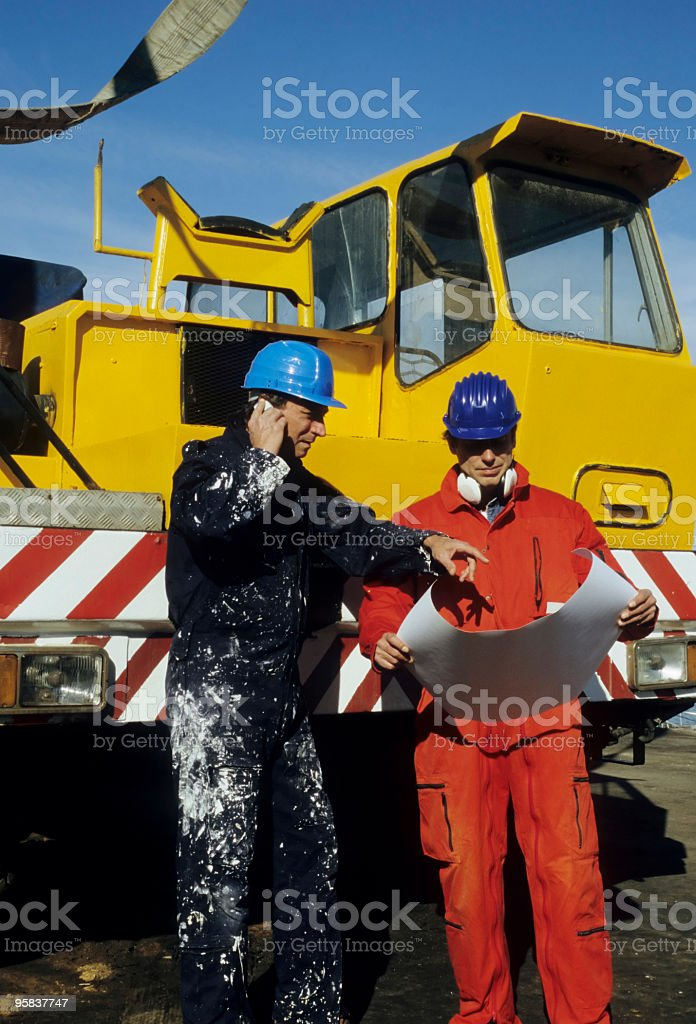 Mechanic and Engineer Planning royalty-free stock photo