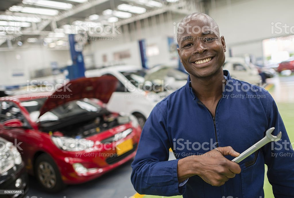 Mechanic at a car garage stock photo