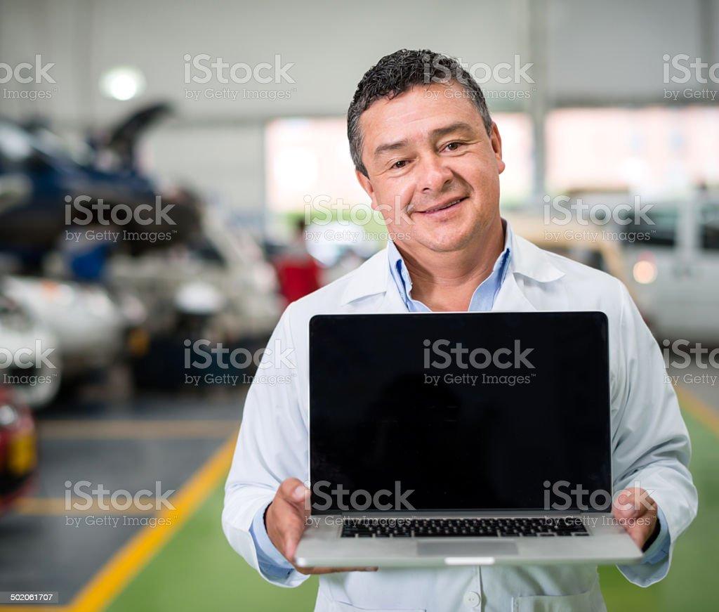 Mechanic at the garage royalty-free stock photo