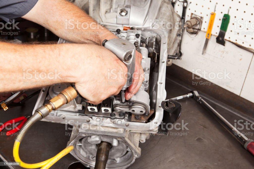 Mechanic Bolting Transmission Valve Body Components stock photo