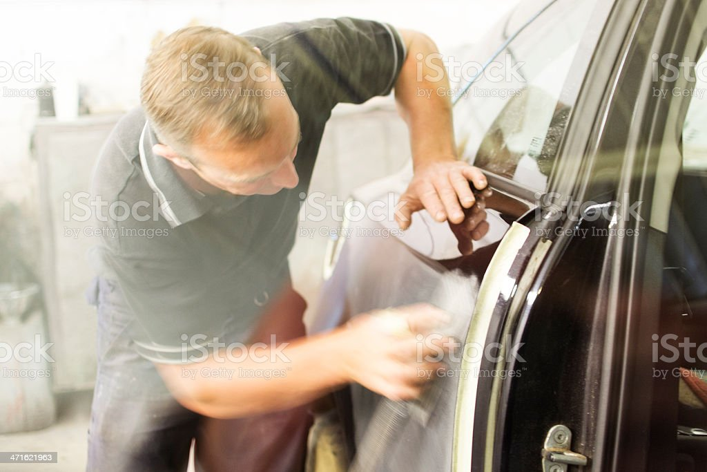 Mechanic carrying out body work stock photo
