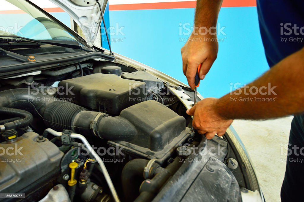 Mechanic change air filter in a diesel engine car stock photo