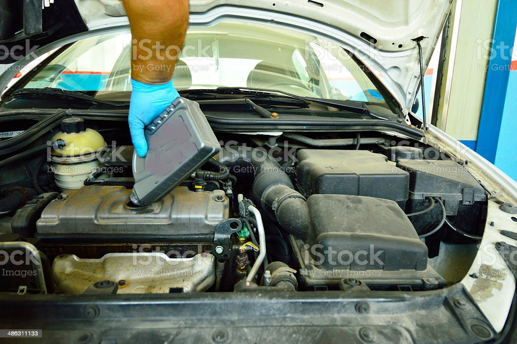 mechanic change the oil in a diesel car stock photo