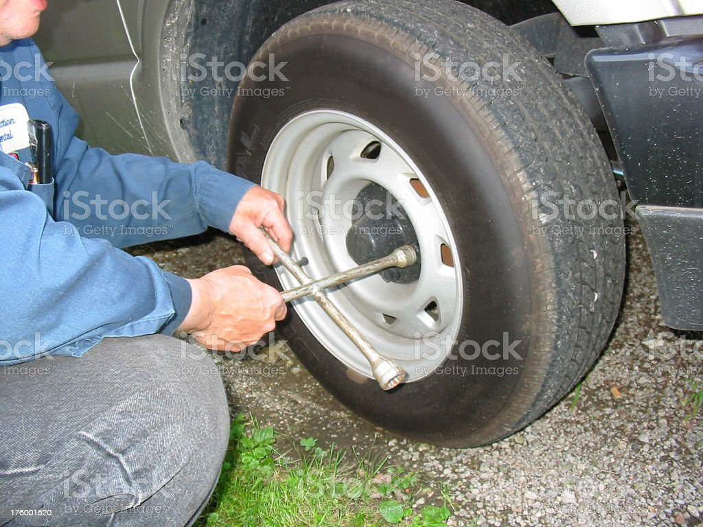 Mechanic - Changing A Tire royalty-free stock photo