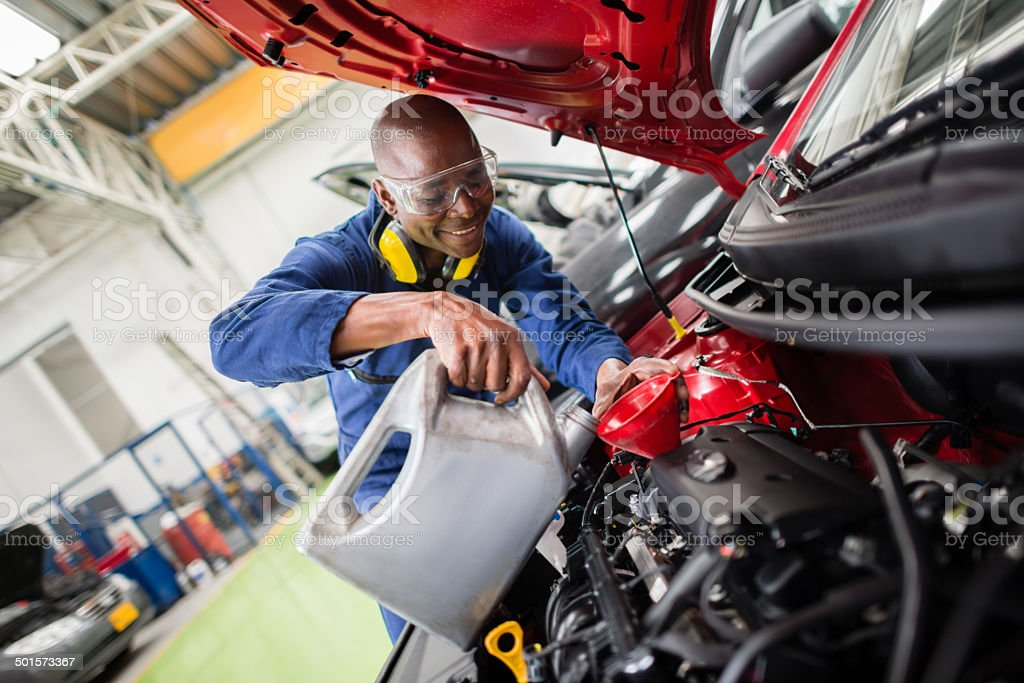 Mechanic changing oil stock photo
