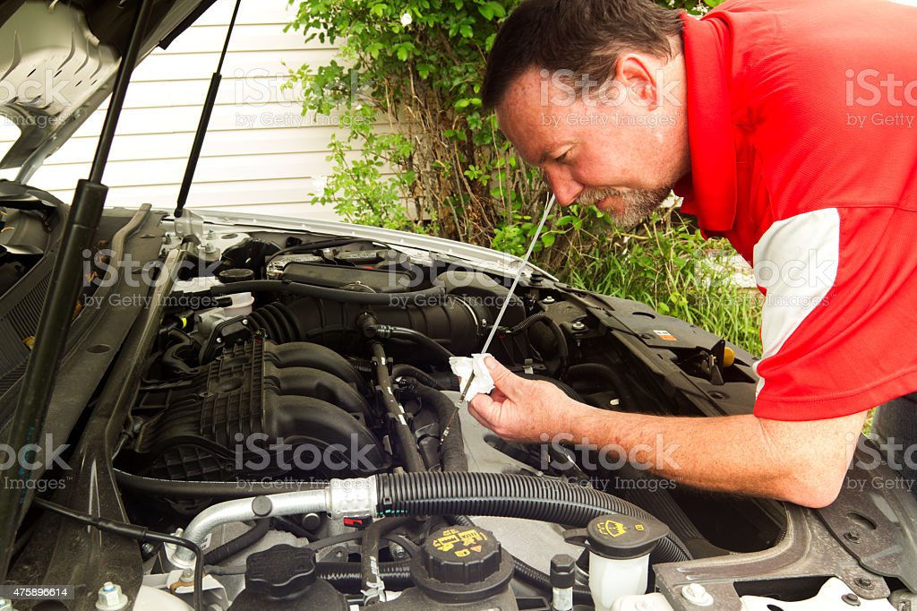 Mechanic Checking The Oil In A Newer Car stock photo
