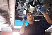 Mechanic checks exhaust