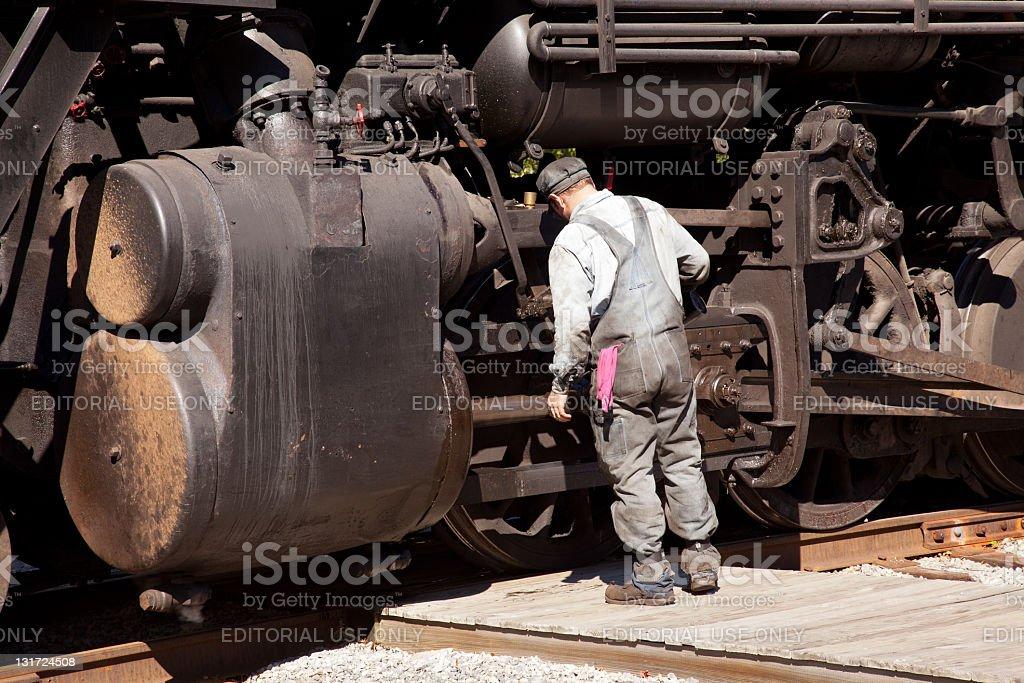 Mechanic checks locomotive royalty-free stock photo