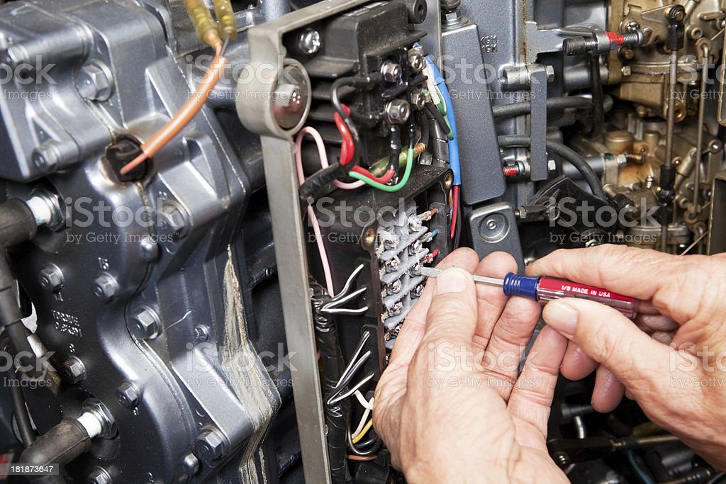 Mechanic Connecting Outboard Marine Engine Wire stock photo