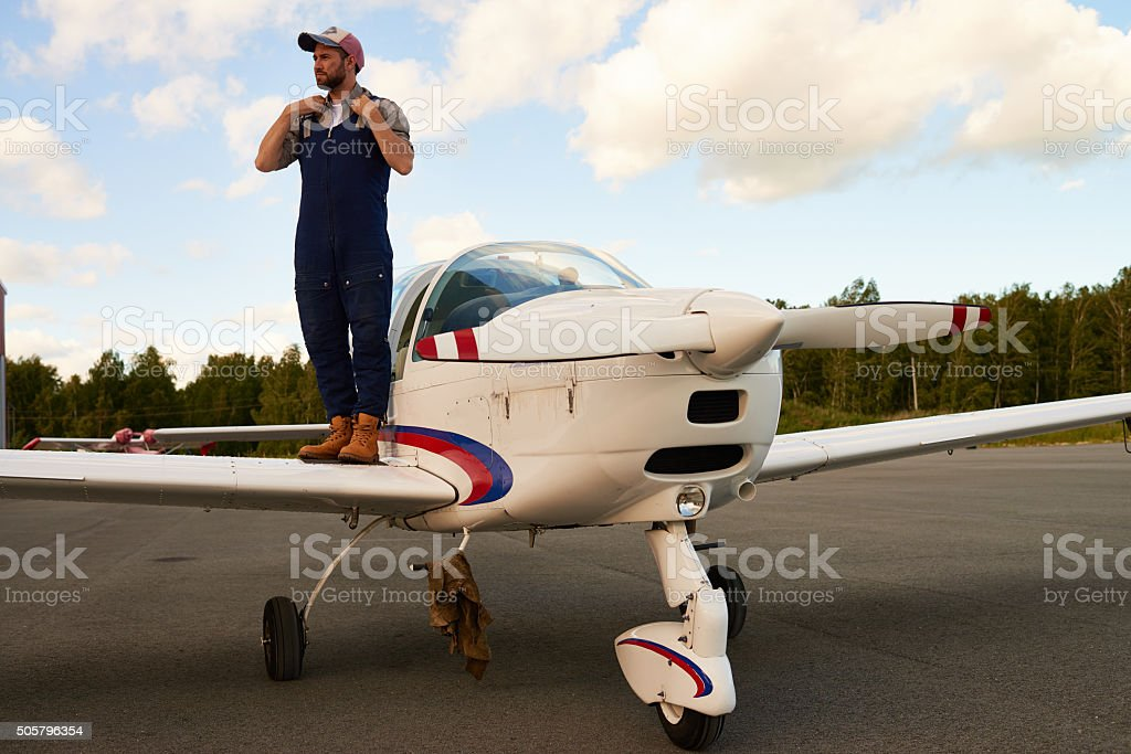 Mechanic falling in love with sky stock photo