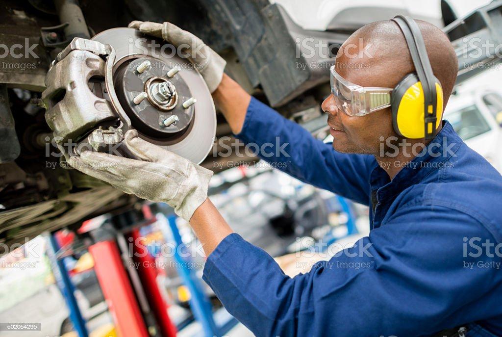 Mechanic fixing a car stock photo