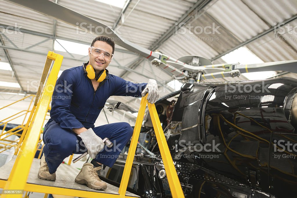 Mechanic fixing a chopper royalty-free stock photo