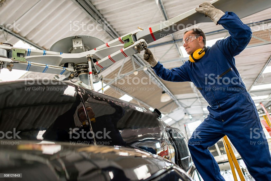 Mechanic fixing a helicopter stock photo