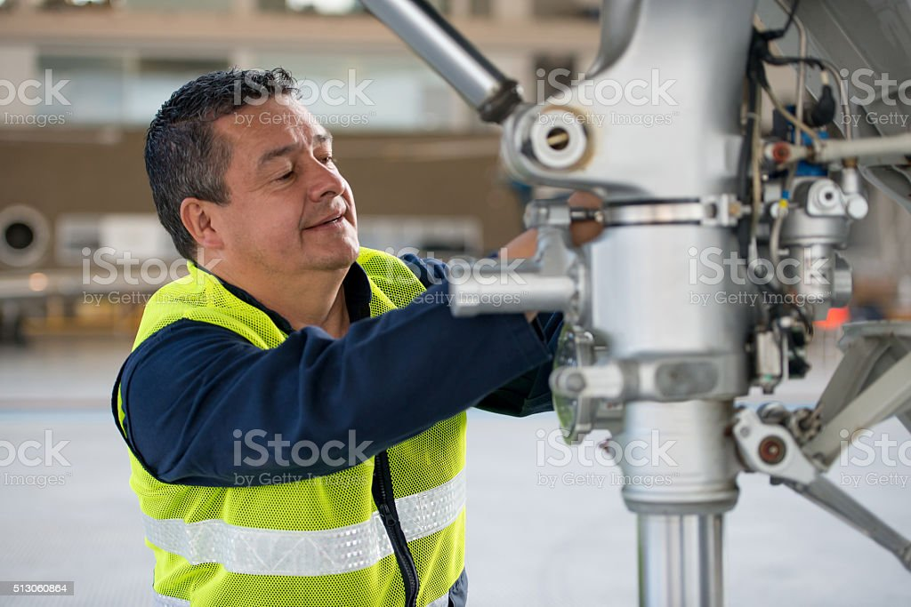 Mechanic fixing an airplane stock photo