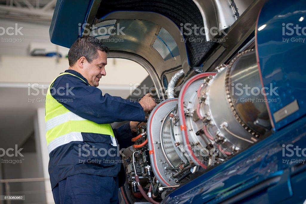 Mechanic fixing an airplane stock photo