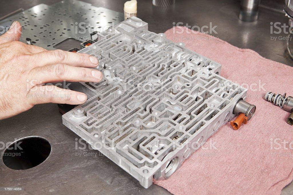 Mechanic Greasing Transmission Valve Body royalty-free stock photo