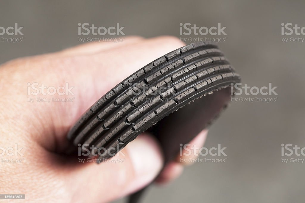 Mechanic Holding a Cracked Serpentine Belt royalty-free stock photo