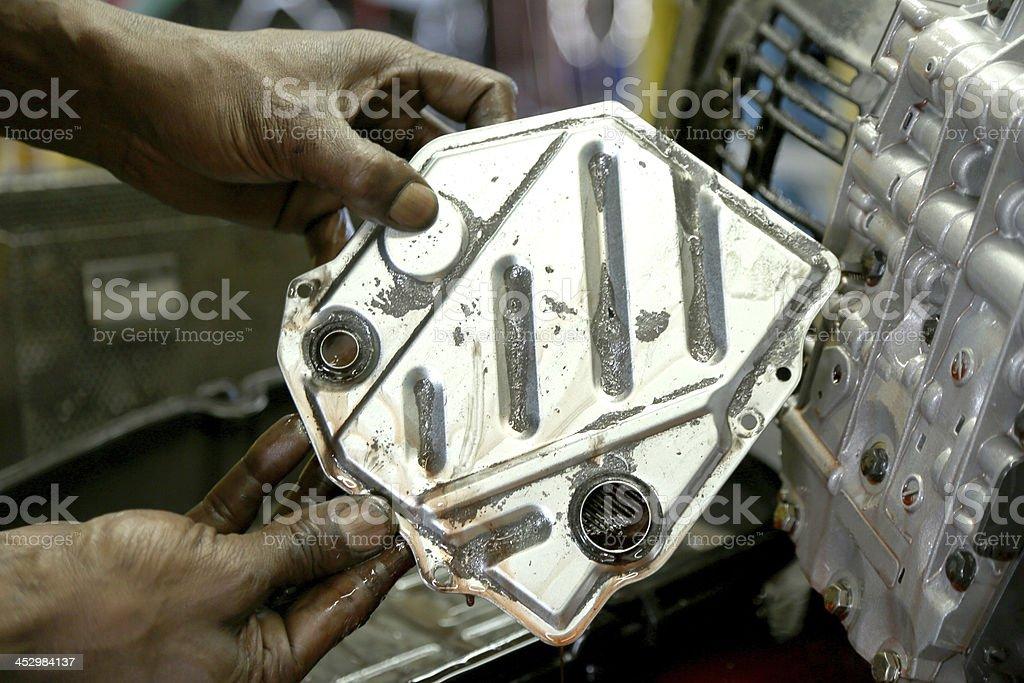 Mechanic Holding Auto Transmission Part stock photo