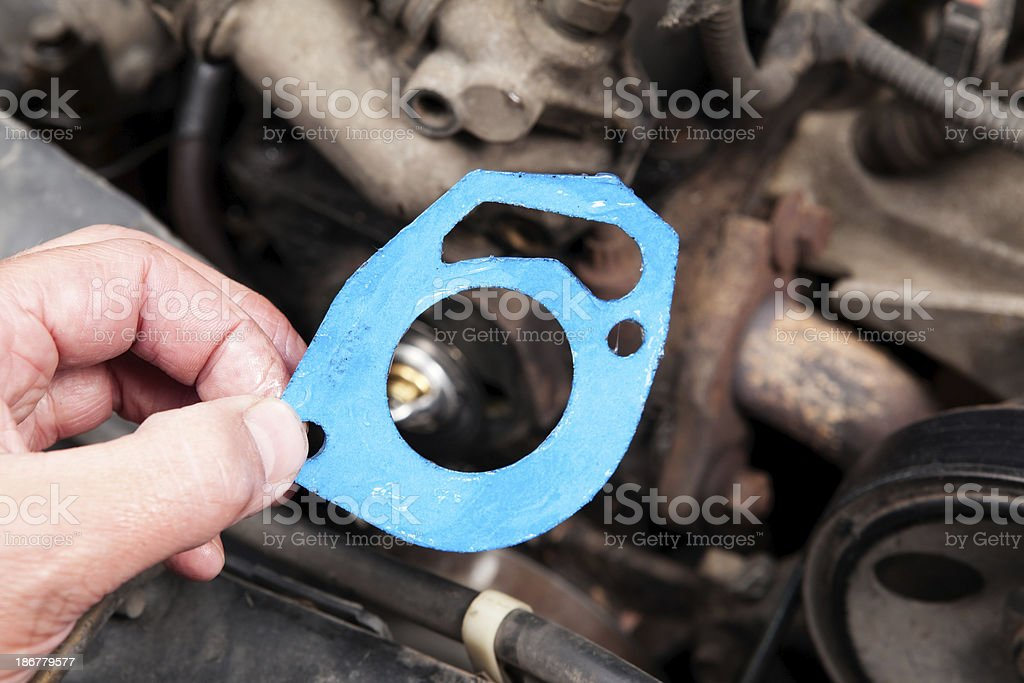 Mechanic Holding Gasket for Engine Block Installation royalty-free stock photo