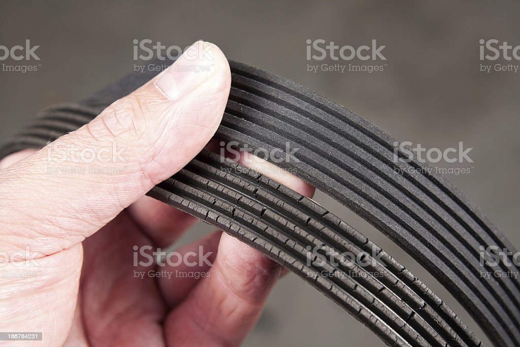 Mechanic Holding Old and New Serpentine Belts royalty-free stock photo