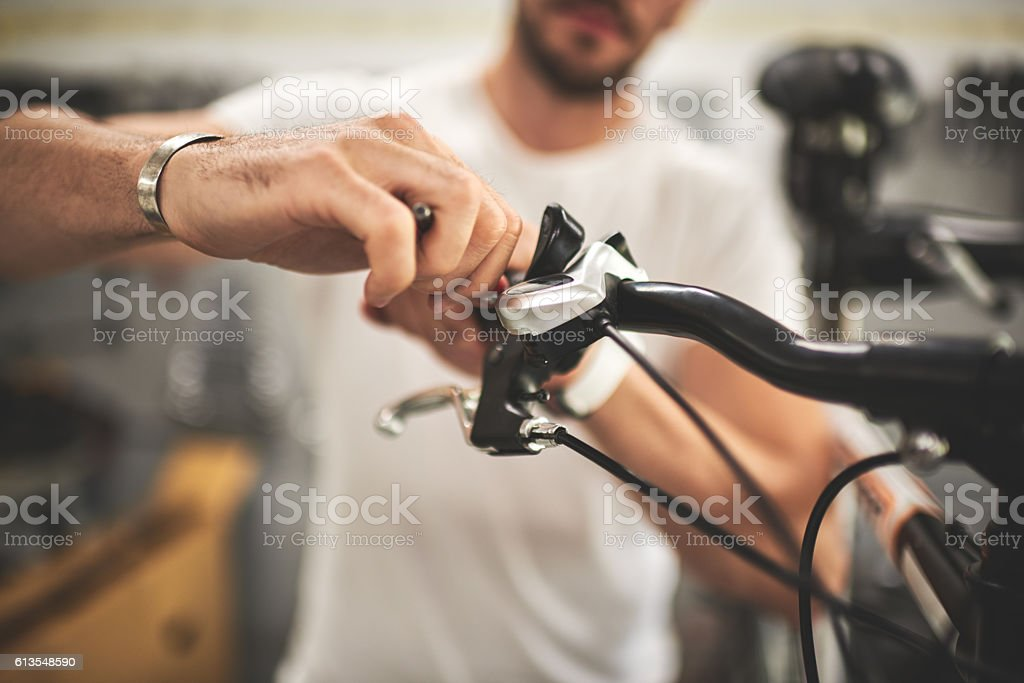 Mechanic in bicycle store stock photo