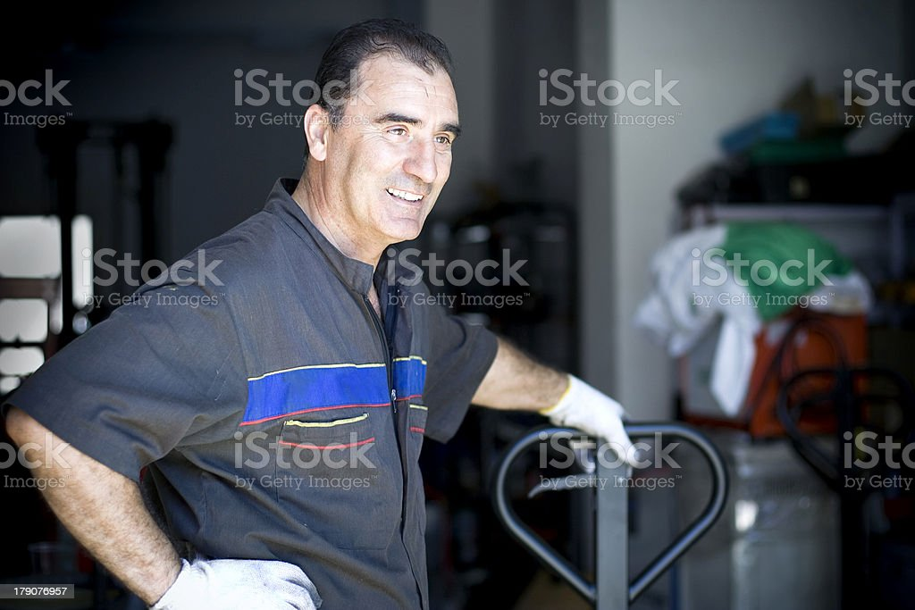 Mechanic in his Shop stock photo