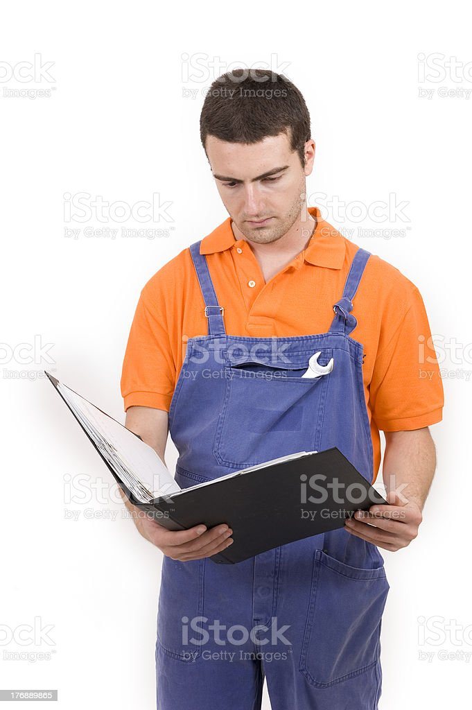 Mechanic in overall holding clipboard royalty-free stock photo