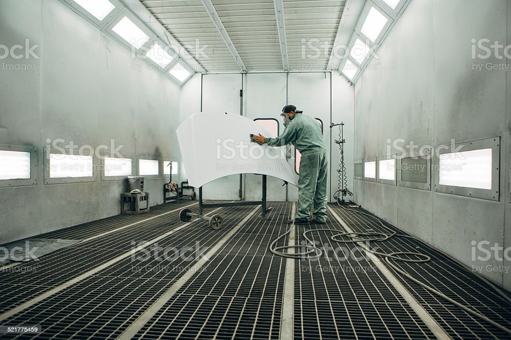 mechanic in Painting Booth stock photo