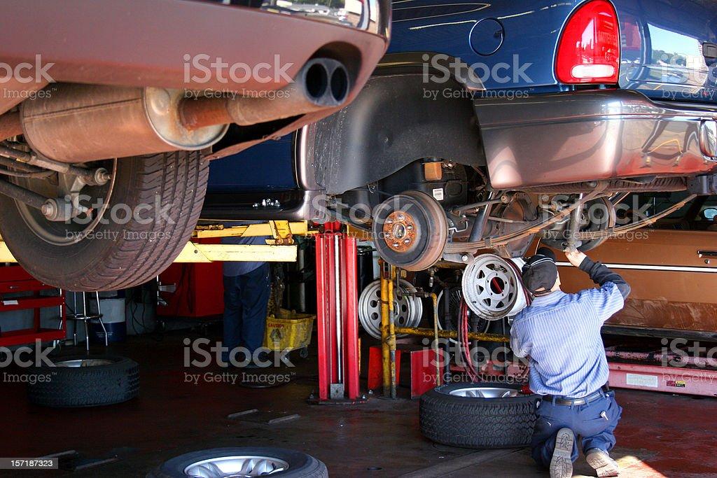 Mechanic Inspecting Vehicle royalty-free stock photo