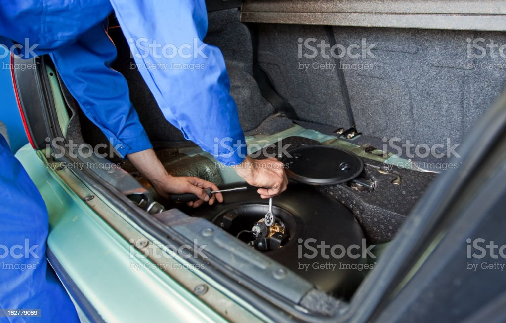Mechanic installs a tank for Liquefied Petroleum Gas stock photo