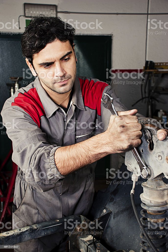 Mechanic is working in a repair shop. stock photo