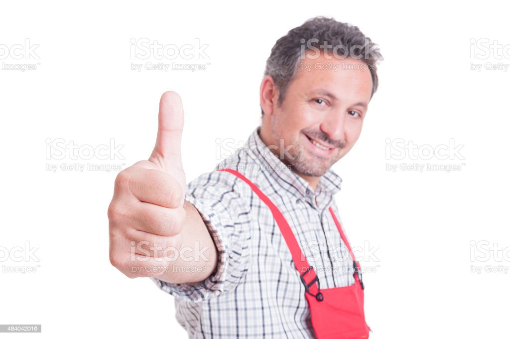Mechanic or plumber showing like or thumb-up gesture stock photo