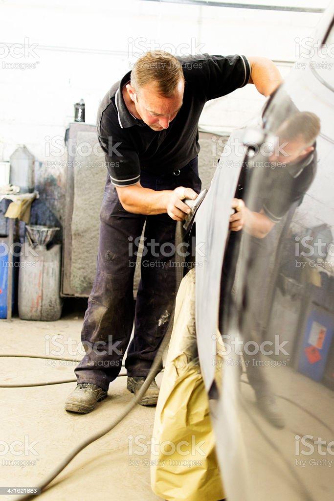 Mechanic performing body work royalty-free stock photo