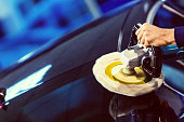 Mechanic Polishing Car