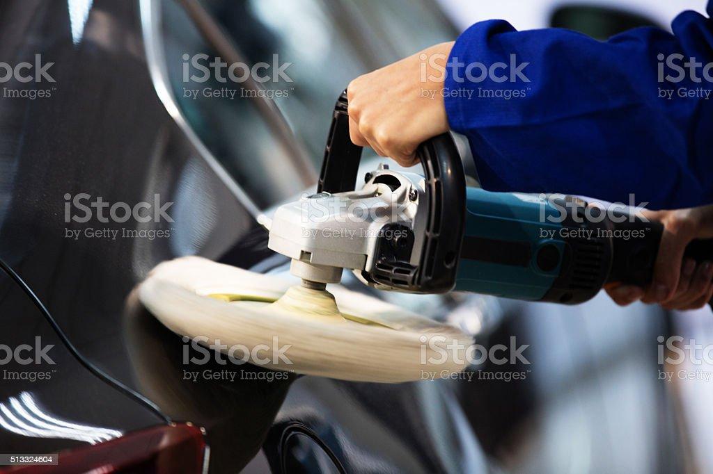 Mechanic Polishing Car stock photo