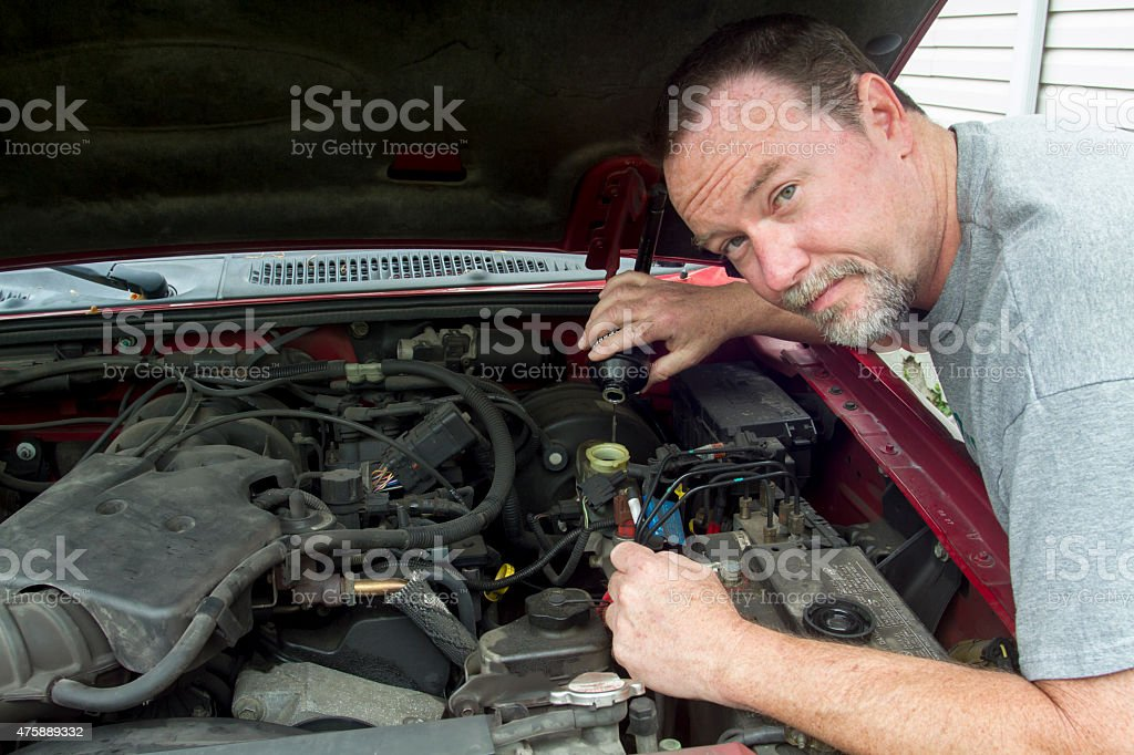 Mechanic Pouring Brake Fluid Into A Master Cylinder stock photo
