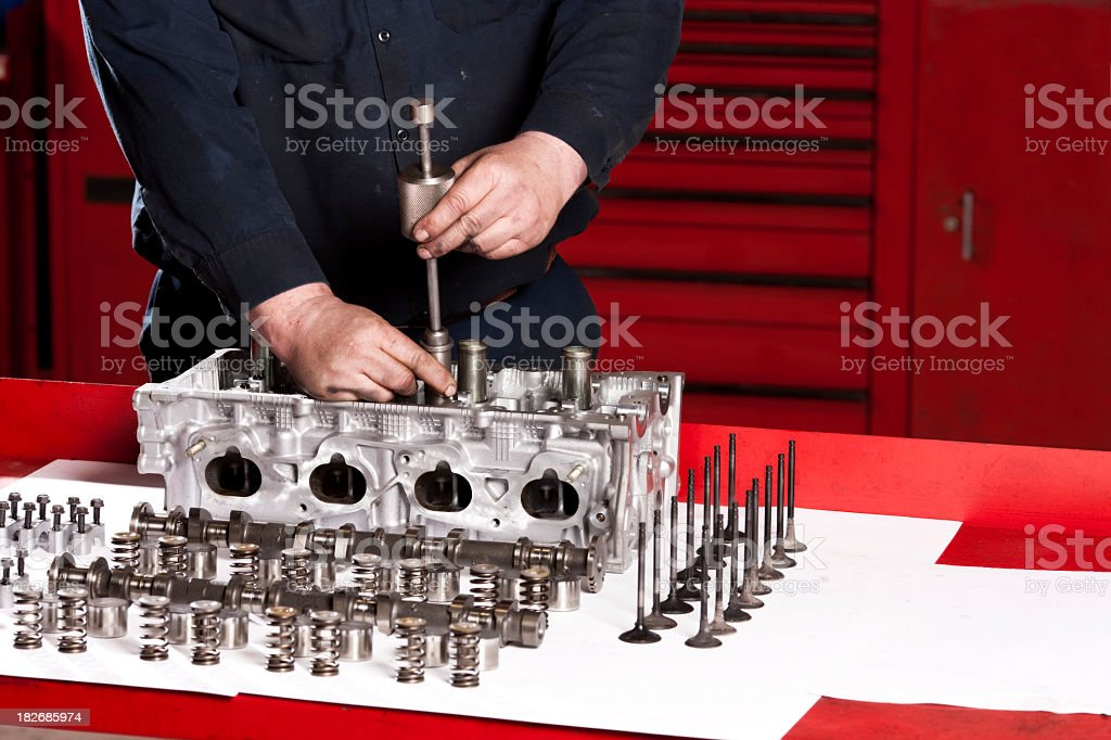 Mechanic Rebuilding Engine royalty-free stock photo