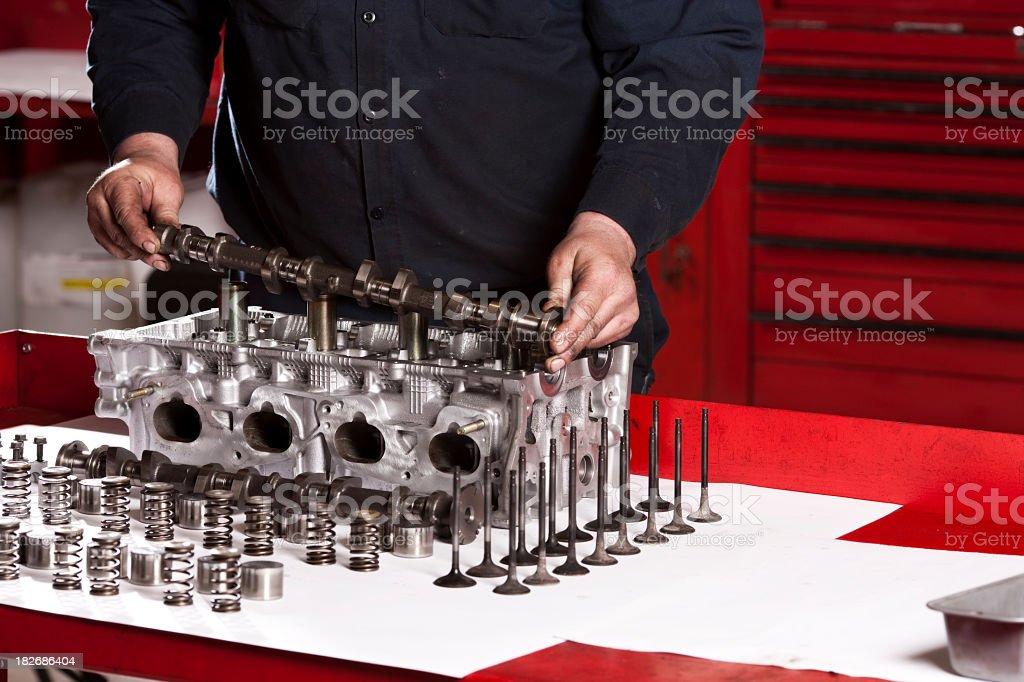 Mechanic Rebuilding Engine-Crankshaft royalty-free stock photo