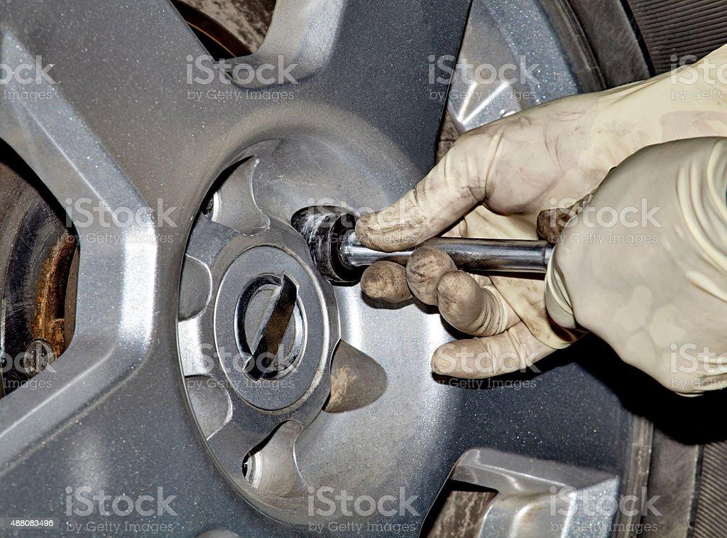 Mechanic Removing Lug Nut stock photo