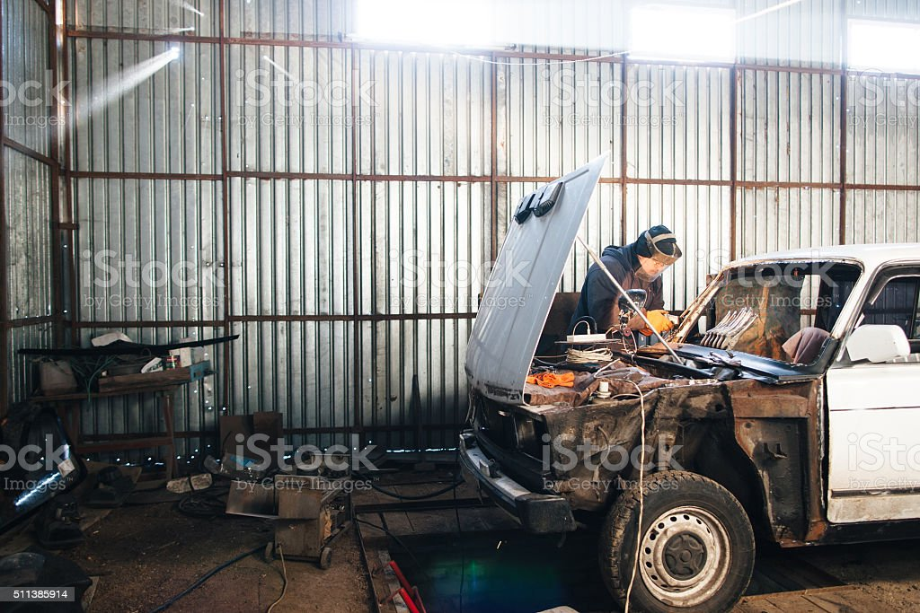 Mechanic repair and service car in garage stock photo