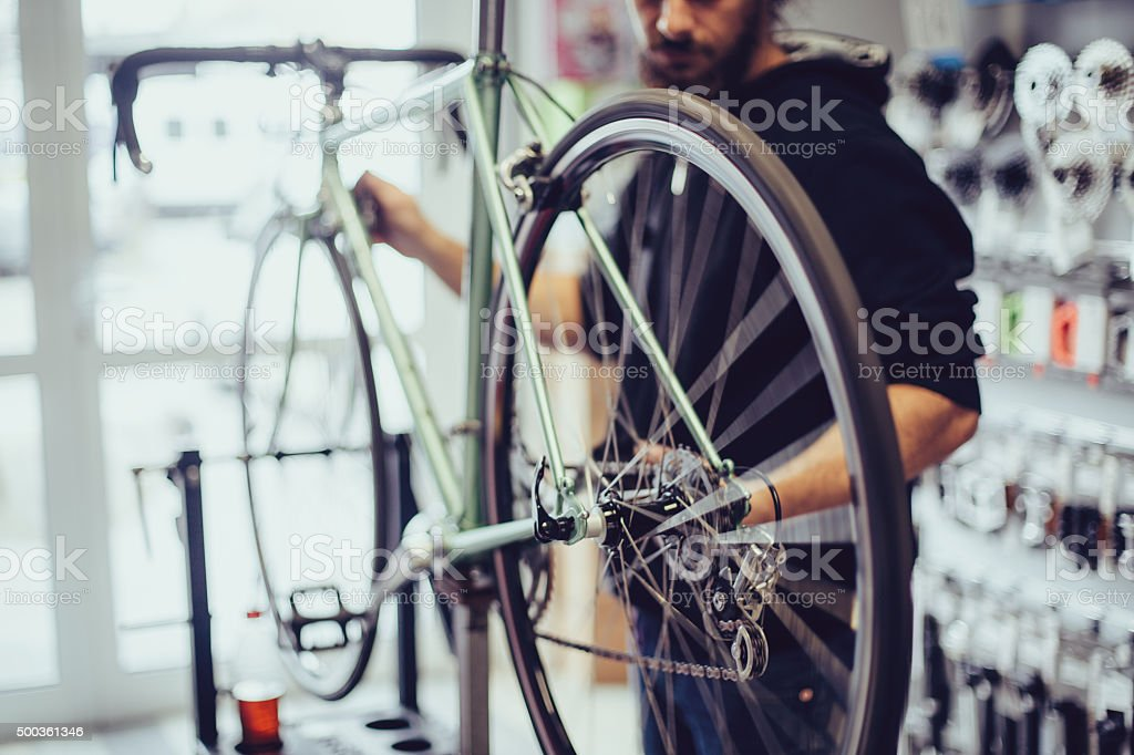 Mechanic repairing a bike stock photo