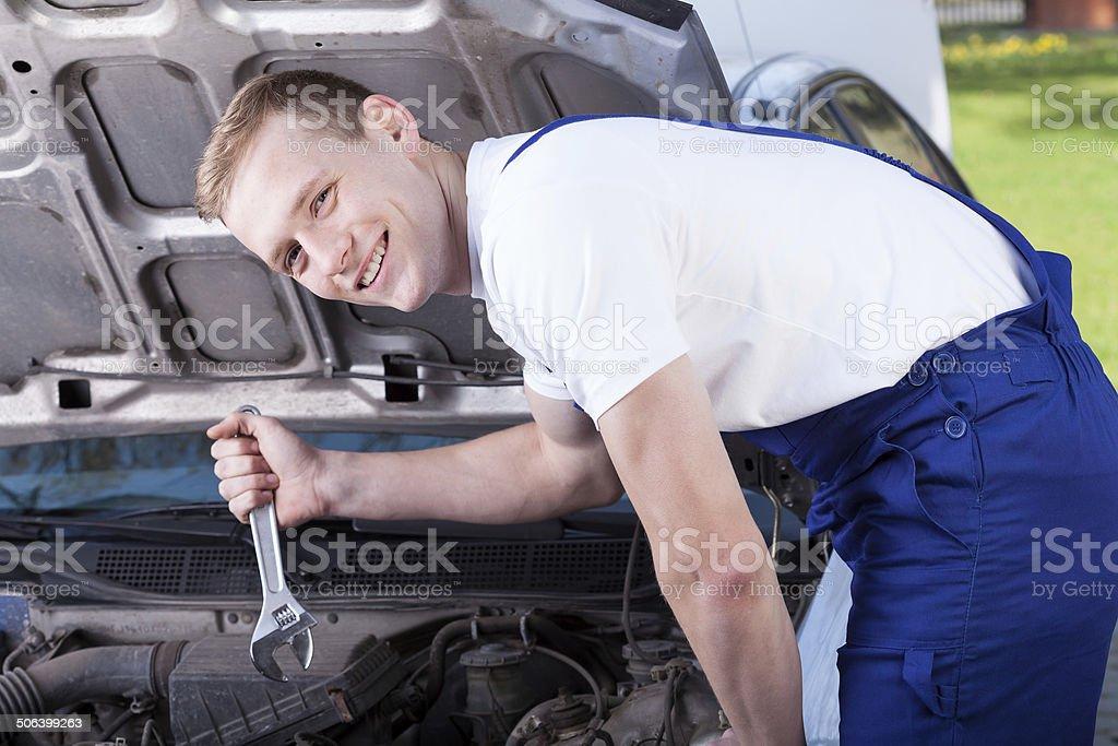 Mechanic repairing a car royalty-free stock photo
