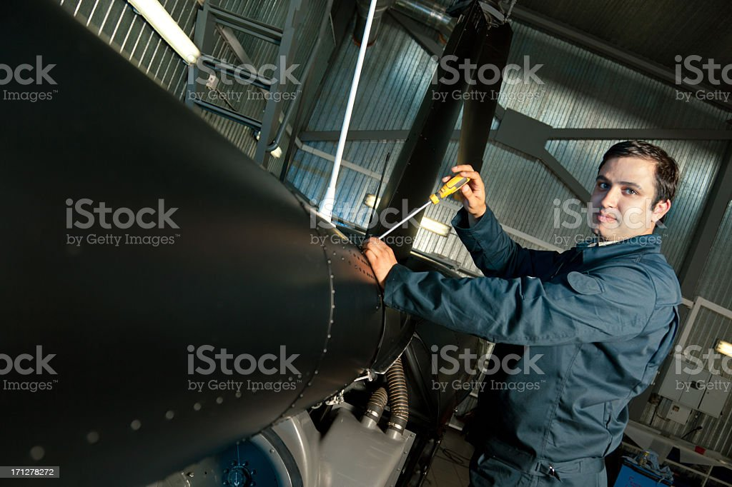 Mechanic repairing a helicopter royalty-free stock photo