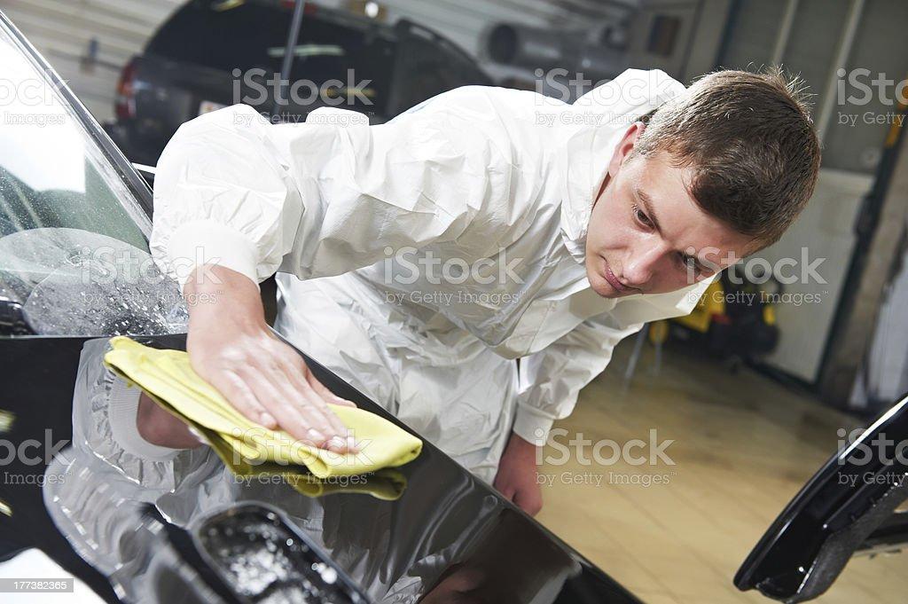 mechanic repairing and polishing car stock photo