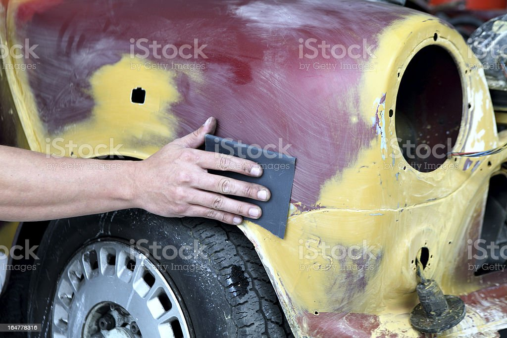 Mechanic repairing car royalty-free stock photo